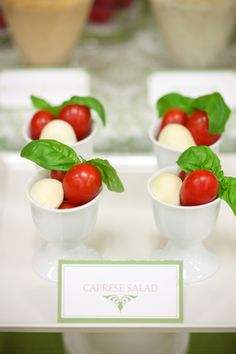 cute twist on caprese salad.  Love the look of caprese skewers.  Also could be cute using hollowed out campari tomato as dish for chopped basil and marinated mozzarella