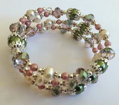 Artful Evidence: Memory Bracelets : 8mm Olivine Glass Pearls, 7-8mm Ivory Fresh Water Pearls, 8mm Faceted Rondelle Rose Green Crystals, 4mm Pink Illusion Beads, silver plated spacer beads and bead caps.