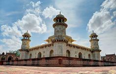 """Tomb of I'timād-ud-Daulah is a Mughal mausoleum in the city of Agra in the Indian state of Uttar Pradesh. Often described as a """"jewel box"""", sometimes called the """"Baby Tāj"""", the tomb of I'timād-ud-Daulah is often regarded as a draft of the Tāj Mahal."""
