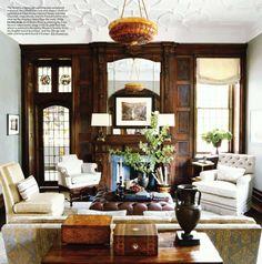 Wood paneled wall, plaster ceiling