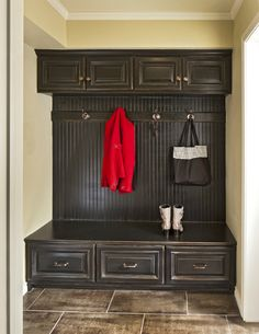 Mud room with black antiqued cabinets