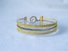 bracelet handmade bobbin lace out of yarn gold with by UliBaysie, €39.90