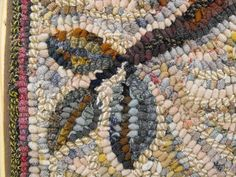 Up close pic of Karen Kahle's rug, showing how she uses different colors in the same value to hook an interesting background.