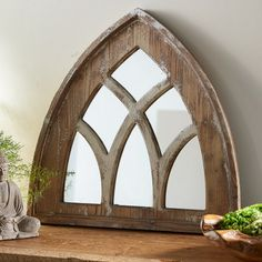 Cathedral Window Mirror: Capturing the rustic appeal of classic cathedral architecture, this curving mirror gives timeless character to a space. It features artfully distressed paulownia wood arches for a well-worn feeling and a sustainable twist.