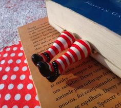 A wonderful git for any occasion! The funny part that comes out from your book it's made from clay (about 5cm), coated with varnish.