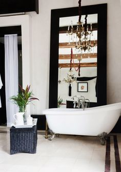 Beautiful bathroom with white tub and exposed wood ceilings