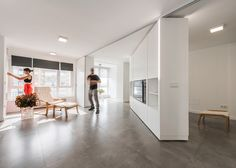 As part of an ongoing project that aims to maximize the living space of small apartments, Madrid-based office PKMN architectures designed the MJE House, a 70 sqm apartment in Salinas, Spain, arranged around a rotating central unit.