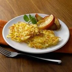 Simply Traditional Potato Pancakes Recipe - Grated carrots add a touch of sweetness and a splash of color to these tasty pancakes. Top with applesauce or sour cream if desired.