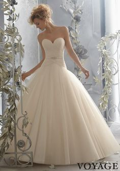 THIS dropped waist, is the waistline I think will look best on you. This dress is beautiful.