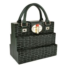 Stylish trunk design made of a combination of printed hair on hide and fine green Napa leather, finished with the signature OYSBY lipstick clasp closure.  Perfect for that special event or celebration.