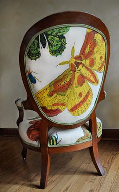 If a chair could have wings, it would be this one. The perfect focal point, this lovely Victorian chair was artfully reupholstered by Noelle with South African screened prints. http://noelschairs.tumblr.com/
