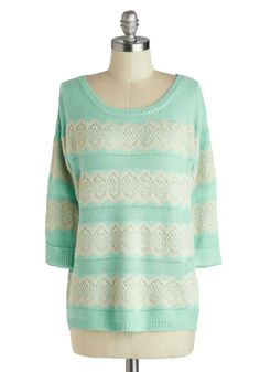 A soft billow of steam puffs into the crisp spring air as you fill your favorite mug. Like the gentle hug of this knit aqua sweater, the aroma of fresh tea fills you with a feeling of blissful comfort.