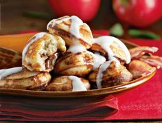 Cinnamon-Bun Filled Ebelskiver: With their fragrant cinnamon-sugar filling and drizzle of cream cheese frosting on top, these pancakes evoke all the sweet flavor and nostalgia of that bakery favorite: warm cinnamon buns. Whip them up as a special treat on chilly mornings.