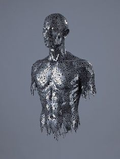 Korean artistYeong-Deok Seocreates imposingfigurative sculpturesusing tightly knit configurations of welded bicycle chains and industrial steel chains.