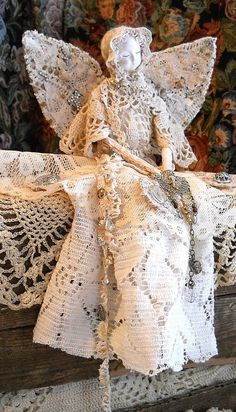 Special mantle-sitting angel in crocheted lace decorated with a bit of shine. A lovely vision.