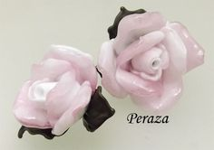 A single rose blossom.  Hand made sculptural rose lampwork bead.  Made to order in a variety of colors - Full bloom $45.00; smaller bloom $35.00.