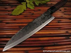 Traditional Japanese kitchen knife from Master Takeda – a traditional Mioroshi Debain the Kuro-Uchi style finish. The Mioroshi is a very refined style of knifeused mostly for Meat preperation and excels at filleting all manner of Fish. Amazing slicing ability.    Master Takeda hand forged the Aogami Super Steel blade which is approx 7 3/8″ long (18.7cm) and this beautiful blade has one of the clearest full length Hamons  seen!