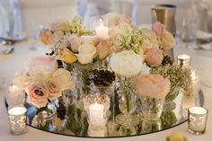 Round Table Centerpiece with Flowers and Candles - 28 Centerpieces for Round Tables (in Different Styles) - EverAfterGuide