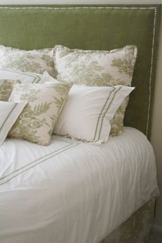 love the details, the silver nailhead trim and the repeating pattern on the pillow case and duvet.