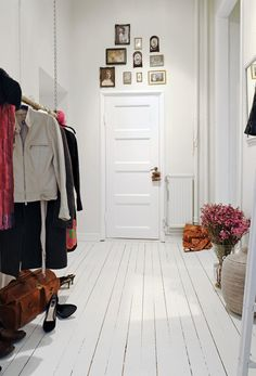 Great walkway for your home-open clothes rail and painted wooden floors offers this rustic look I adore