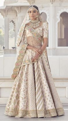 Sabyasachi Bridal Lehenga Online on Happy Shappy. Browse trending collection and price range for bridal and wedding. Indian Bridal Outfits, Indian Bridal Fashion, Indian Bridal Wear, Indian Dresses, Bridal Dresses, Indian Wear, Sabyasachi Lehenga Bridal, Indian Bridal Lehenga, Outfits
