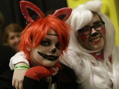 Cincinnati Comicon. Photo: Foxy the Pirate Fox, and Mangle at Comicon celebrating comic creations. The Cincinnati Comicon was held at the Northern Kentucky Convention Center. There were comic books on display, illustrators and costumes. Saturday, Sept. 12, 2015. Tony Tribble for The Enquirer