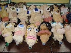 Papier mâché over bottles to make puppet heads.