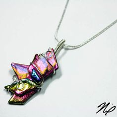 Abstract Wire Wrap Fused Dichroic Rainbow Glass by Nixcreations, $44.99    The glass in this pendant was created by my friend May. I bought this glass before I started making my own glass several years ago. I thought I would wire wrap it and offer it as a beautiful pendant. This pendant is wire wrapped with nontarnishing shiny silver wire so you don't have to worry about it tarnishing.    This pendant measures 2 x 0.75 inches