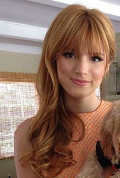 strawberry blonde hair with bangs