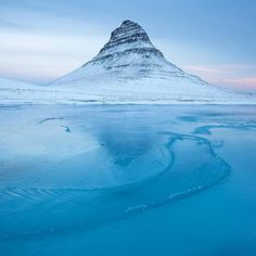 @trex.photography exploring the frozen winter wonders of Kirkjufell, Iceland ------------------------------------------ Tag #thisworldexists to feature! ------------------------------------------ ThisWorldExists is a community of travellers & explorers inspiring awareness and social change by contributing to and supporting improved education across the globe.  Support our @thisworldexists_projects with any purchase from our online store or better yet, feed your hunger for adventure and warm…