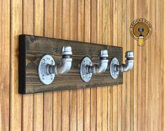 Decorating with coat racks and vintage clothing Coat Hooks Wall Mounted, Decorative Wall Hooks, Mason Jar Light Fixture, Mason Jar Lighting, Light Fixtures, Bathroom Rack, Bathroom Towels, Kitchen Towels, Basement Bathroom