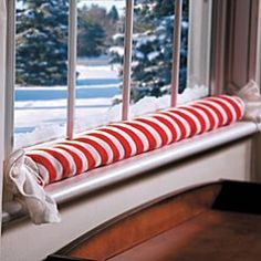 window draft stopper - I like how this is like a piece of colorful holiday candy, tied at the ends. Window Draft Stopper, Door Draught Stopper, Door Draft Guard, Indoor Christmas Decorations, Energy Saver, Holiday Candy, Space Saving Storage, Making Life Easier, Christmas Sewing