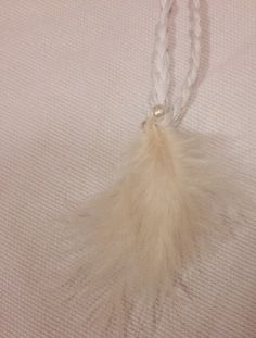 Feather necklace. http://www.etsy.com/shop/AmisIdeas