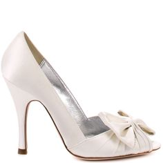 Elegance and luxury flow together to create this Bourne pump.  Barbara features an ivory satin upper with a gorgeous ribbon bow trimmed with rhinestones.  The 3 3/4 inch heel is perfect for walking down the aisle and will keep you feeling regal through out your special day.