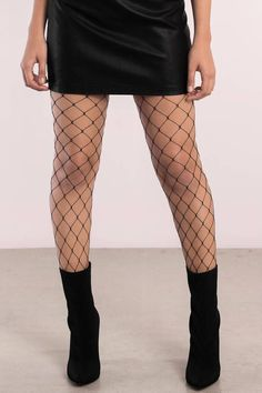 """Search """"Watch Me Black Fishnet Tights"""" on Tobi.com! oversized knit fishnet stocking pantyhose layered under jeans trendy styles fashion style denim layers with tights sexy cute"""