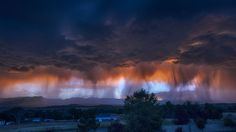 An August afternoon storm in Colorado Springs along the Front Range of the…