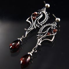 """""""Time Traveler"""", sterling silver / garnet. Hand-sculpted by me, Kristine Schroeder, in sterling silver wire. I do not solder any of my artwork. My Studio Boutique is here =>"""