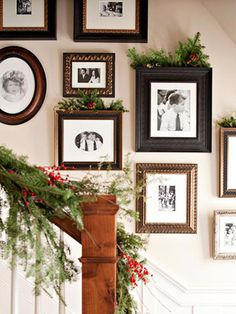 Dress up existing frames on the wall with sprigs of pine and berries. Love the picture arrangement.