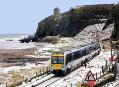 Snow Train - Slow Train.  Castlerock Northern Ireland.  Probably one of the most scenic train journeys in Ireland ........Michael Palin counts it as one of the most beautiful rail journeys in Europe