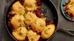 Sausage & Red Bean Skillet with Cornbread Biscuits. The rich flavors of the Louisiana bayou come to you in this easy spin on a classic dish: beans and sausage topped with hearty cornbread. Beans And Sausage, How To Cook Sausage, Enchiladas, Skillet Dinners, Salisbury Steak, Glass Baking Dish, Red Beans, Biscuit Recipe, Dough Recipe