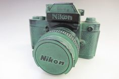 Nikon F2 en bronze !!! ヨドバシカメラ ニコン カメラ型 貯金箱 1978年 10埼78_画像1