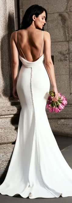 Simplicity. Tamora wedding dress by Kelly Faetanini // Fitted crepe fit-to-flare gown with open cowl back.