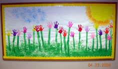 Spring Bulletin Board Idea.                           Handprint Spring Mural.                              Paint yellow sun in corner. Add hand print rays. Handprint light blue clouds in sky. Handprint green grass. Paint tall stems with brush. Add handprint flowers.