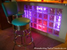 Does this look cool or what?!!! It's a DIY glass block wall with neon lights.