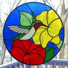 Happy hummingbird feeds from a yellow flower in this original design stained glass suncatcher. Stained Glass Suncatchers, Stained Glass Crafts, Faux Stained Glass, Stained Glass Designs, Stained Glass Panels, Stained Glass Patterns, Painting On Glass Windows, Stained Glass Flowers, Mosaic Art