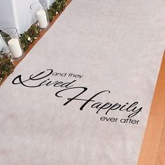 """This would look nice on the beach. Maybe I could add some color or have pictures printed on it?  """"And They Lived Happily Ever After""""; Aisle Runner - OrientalTrading.com"""