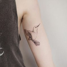 Cute Humming Bird Tattoo, not a fan of the placement though.