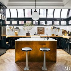 At the Manhattan apartment of designers Nate Berkus and Jeremiah Brent, the kitchen is outfitted with cabinetry and butcher-block countertops. Classic Kitchen, New Kitchen, Kitchen Dining, Kitchen Decor, Kitchen Ideas, Brass Kitchen, Kitchen Black, Kitchen Interior, 1960s Kitchen