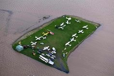 Aircraft surrounded by flood water after heavy rain during Cyclone Debbie. Lismore Airport , New South Wales, Australia.