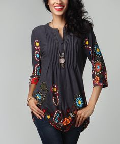 A pin-tucked bodice accents the playful cut of this relaxed tunic crafted from lightweight, stretch-infused fabric that offers supreme comfort. Note: This is a one-of-a-kind item; prints may vary.Made for zulilyModel: 5' 8'' tall; 33'' chest; 24'' waist; 35'' hipsSize S: 33'' long from high point of shoulder to hem; 32'' bustTrue to sizeKnit96% rayon / 4% spandexMachine wash; hang dryImportedShipping note: This item is made to order. Allow extra time for your special find to ship.